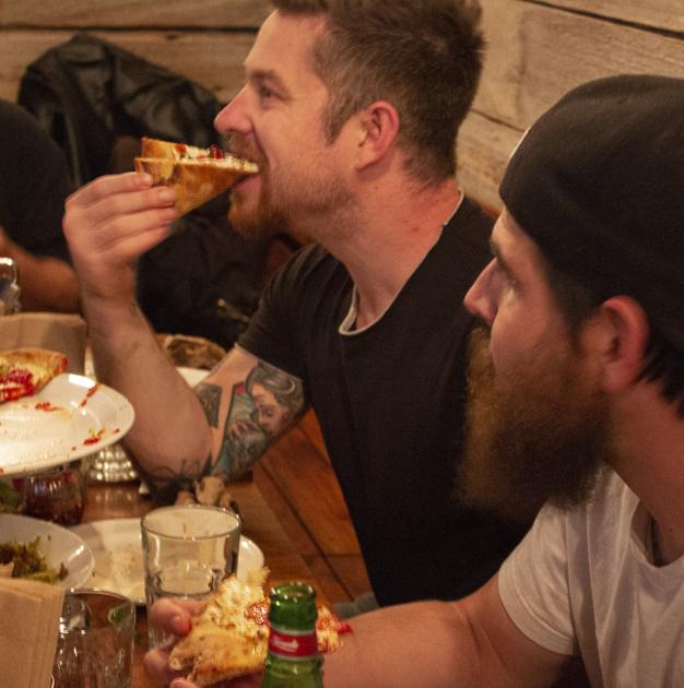 Customers enjoying pizza